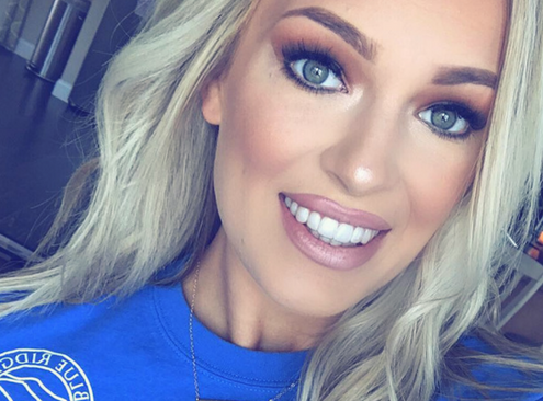 Kate Gonzalez smiles to show off her Impressions invisible aligners