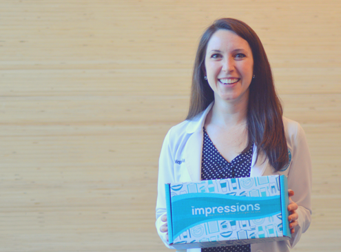 Dr Schüler holds the at home Impressions invisible aligners kit