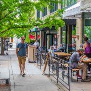 Man walking down street in downtown Asheville