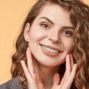 Woman wearing braces to straighten teeth